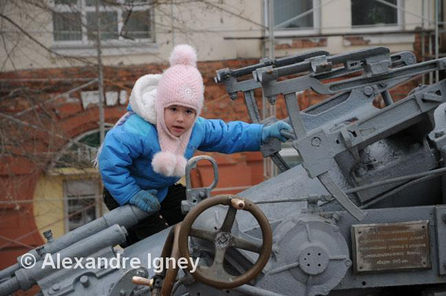 Little Russian girl on a cannon