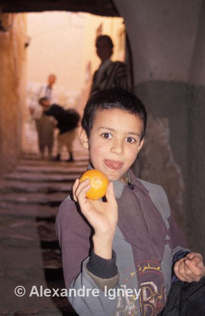 algerian boy with orange