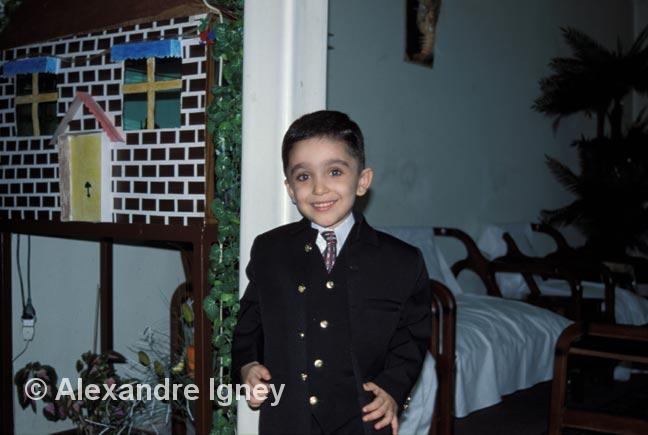 Little Iranian boy in a suit
